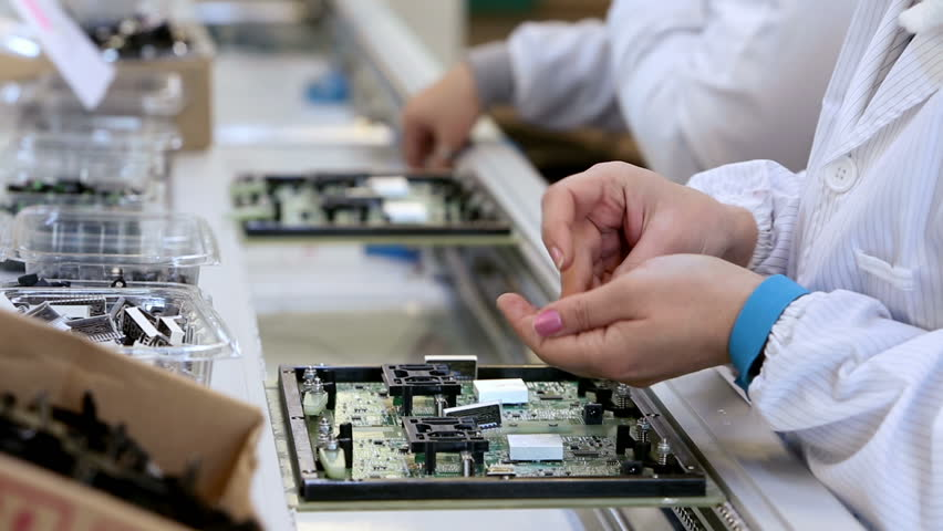 Electronic Assembly Service : Workers are manufacturing circuit boards in electronics