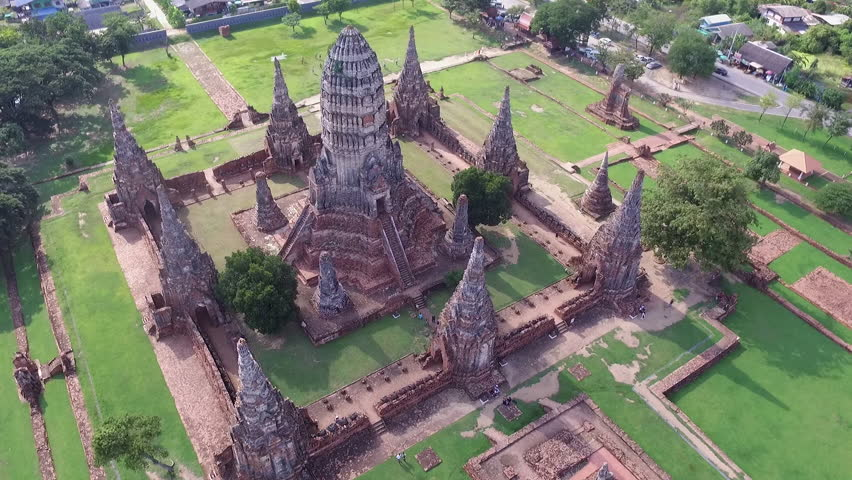 Aerial Shot : Wat Chaiwatthanaram Buddhist temple in the city of Ayutthaya Historical Park, THAILAND Footage from Drones