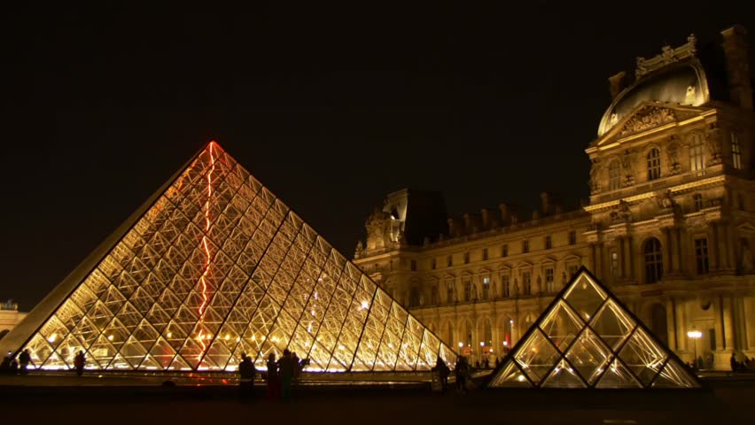 paris the pyramid at the louvre museum illuminated at night with silhouette of people stock. Black Bedroom Furniture Sets. Home Design Ideas
