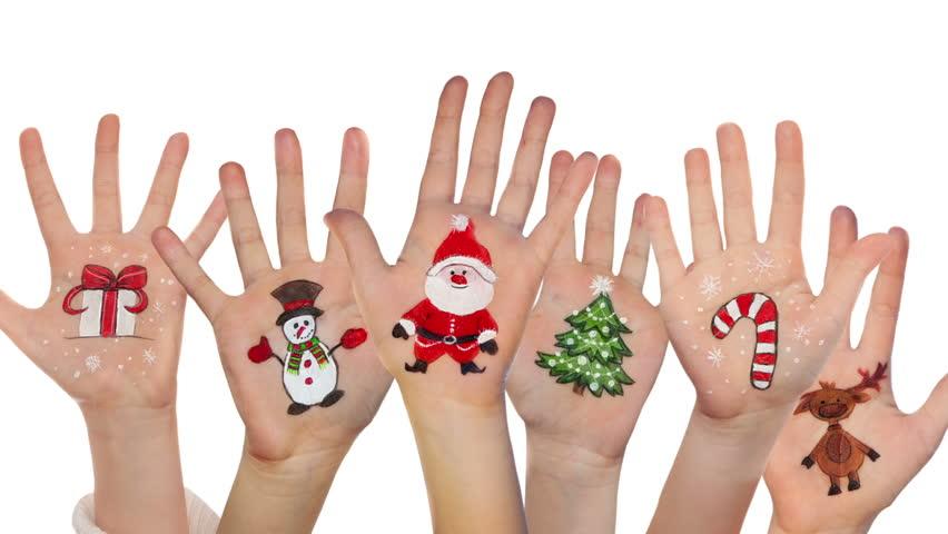 Children's Hands Raising Up With Painted Christmas Symbols: Santa ...