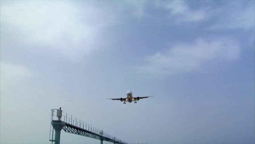 airplane landing over seaside