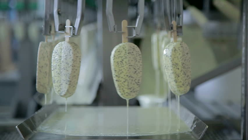 Ice cream preparation. Conveyor with glazed ice cream | Shutterstock HD Video #12845342