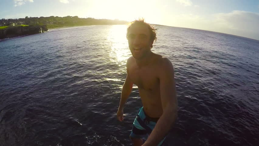 POV Slow Motion GOPRO Selfie Stick Cliff Jumping. Athletic Young Man Jumping From Cliff Into Ocean. Adventure Extreme Sports Lifestyle Hobby Vacation
