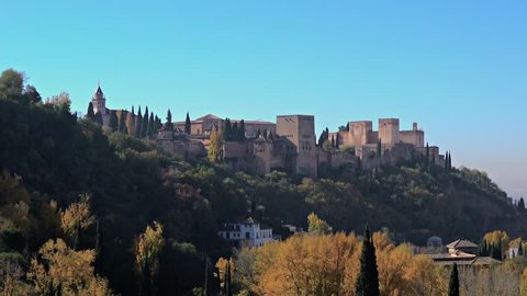 Granada, Andalusia, Spain - Nov 18, 2015. View of the Alhambra palace from Sacromonte district with zoom out.
