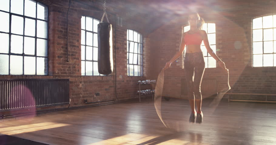 Mixed race Skipping woman training at the gym working out is healthy fitness body kickboxer series