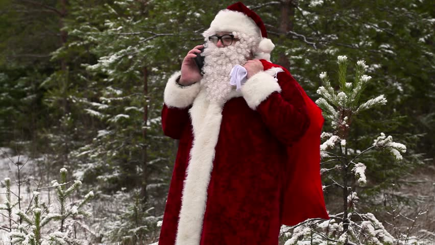 Santa Clause with smartphone in the forest | Shutterstock HD Video #12988397