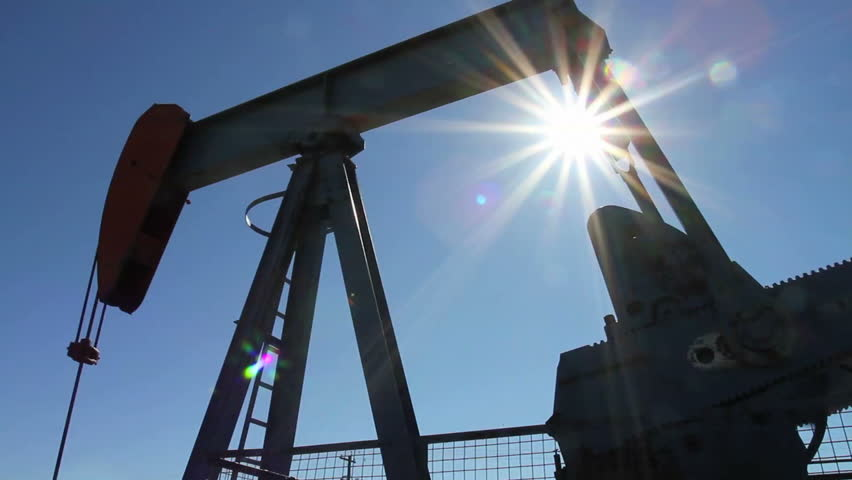 Crude oil pump jack with sunburst
