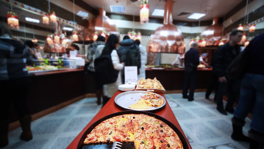 tasty italian pizza in cafe where sells lot of good food, close-up