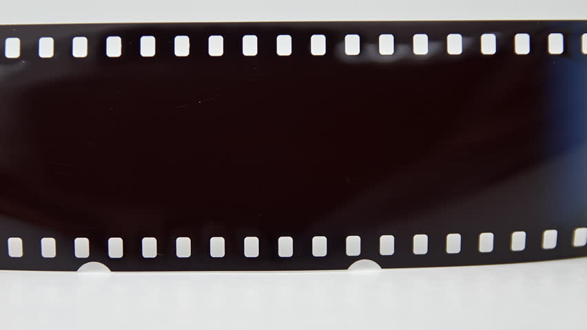 Film Reel Moves Horizontally With Empty Frame In The ...