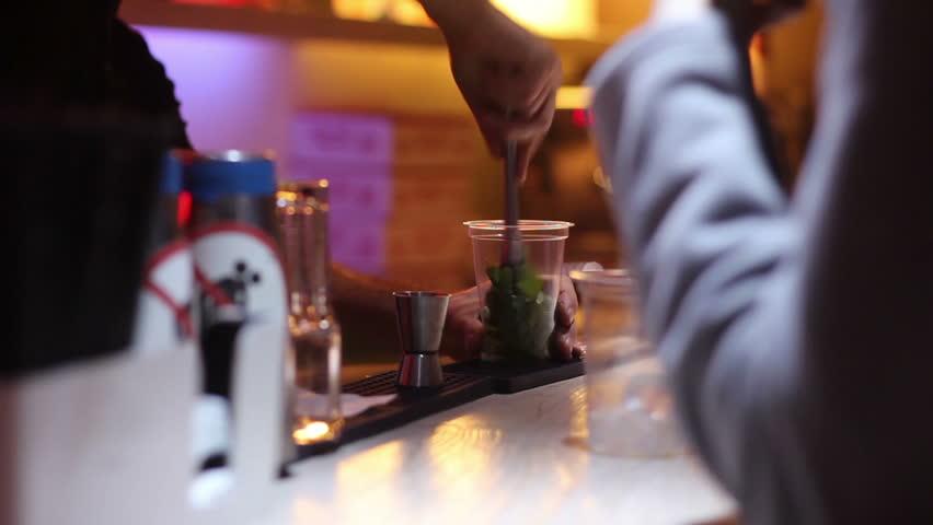 Bartender prepare glass of mojito at bar | Shutterstock HD Video #13042373
