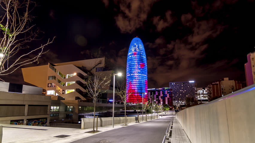 Night hyperlapse (time lapse, time-lapse) of the Torre Agbar at night in Barcelona, Spain