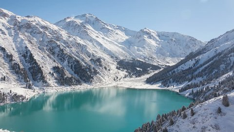 Spectacular view of the Big Almaty Lake in winter time. Time lapse.