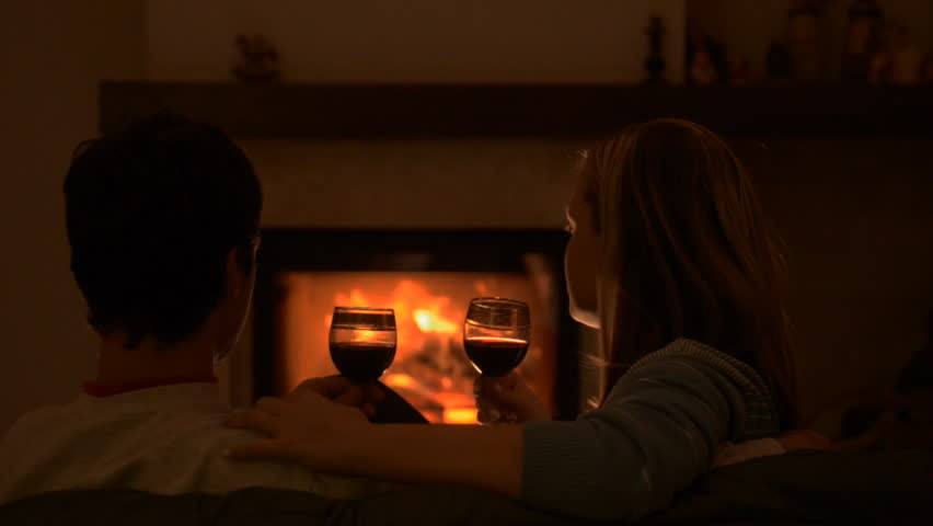 Couple Sitting On Sofa Kissing And Talking By The Fire Stock Footage Video 13087715 -1769