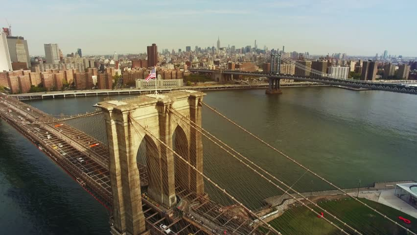 A toned aerial shot of Brooklyn Bridge, New York City. The camera is moving above Brooklyn bridge in the air approaching to Chinatown and upper Manhattan. 4K, Ultra HD video, DJI Phantom 3 pro.