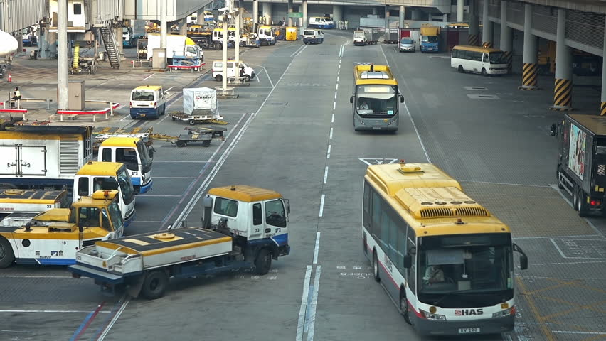 Airport luggage vehicle, bus and truck parking area in airpot. | Shutterstock HD Video #13091723