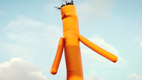 Inflatable waving tube man, generic advertising sign outside