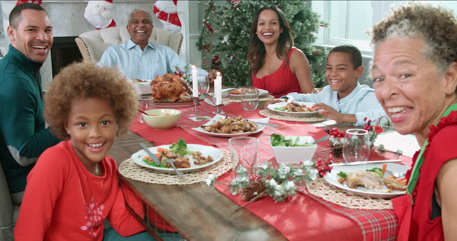Slow Motion Shot Of Family Enjoying Christmas Meal At Table