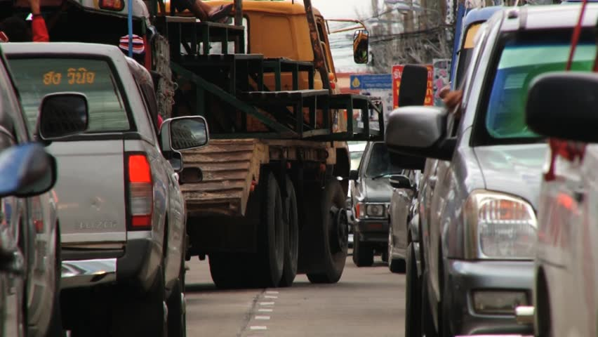 SURIN, THAILAND – NOVEMBER 16, 2013: View to the cars and motorbikes stuck in traffic in Surin, Thailand. | Shutterstock HD Video #13133603