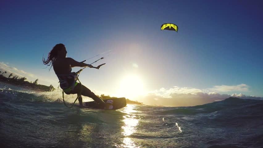 Extreme Kitesurfing Girl Front Flip at Sunset. Summer Ocean Sport in Slow Motion. Girl Kite Surfing in Bikini