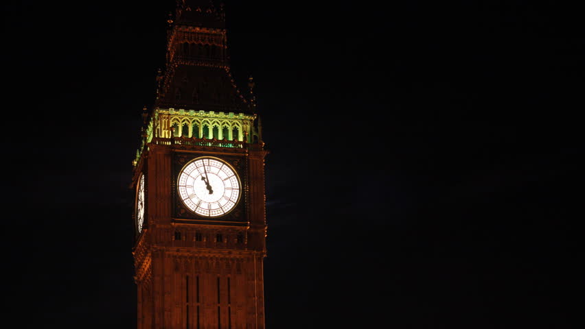 Time Lapse of London's Big Ben with Moon Emerging and Red Double Decker Buses Passing at Night
