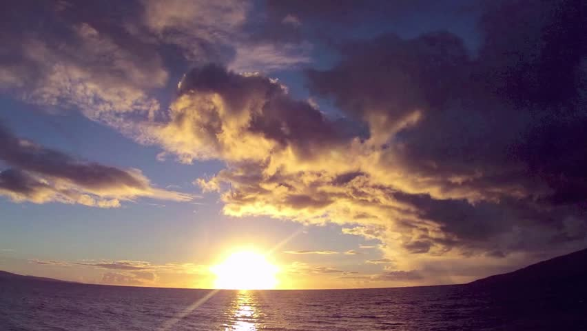 Sunset time lapse with clouds and ocean, North Kihei, Maui
