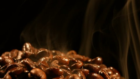 Roasted coffee beans emit smoke