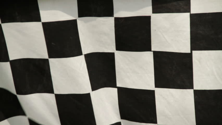 Racing checkered flag in the wind. Real fabric not rendered