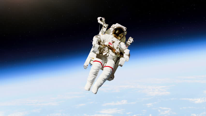 an astronaut in a space suit is motionless in outer space - photo #21