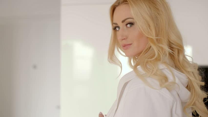 Sensual Girl, Wearing Sweater And Panties Posing On White