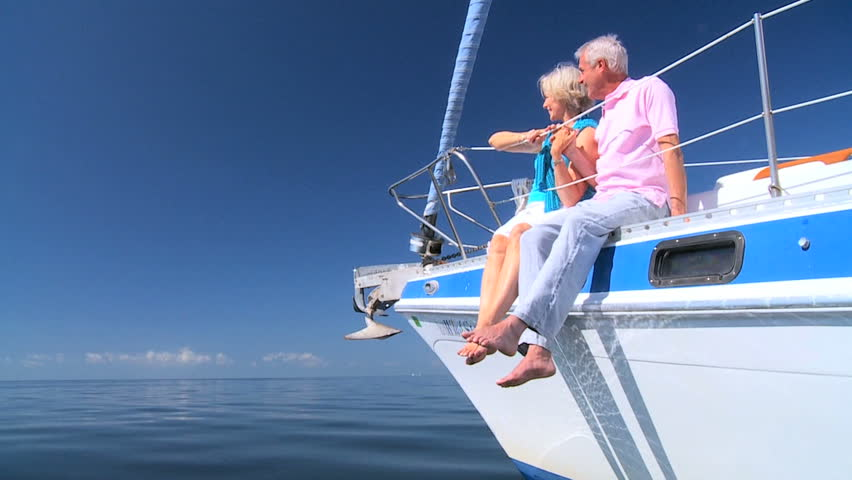 Healthy retired couple enjoying leisure aboard their luxury sailing boat filmed at 60FPS | Shutterstock HD Video #1332676