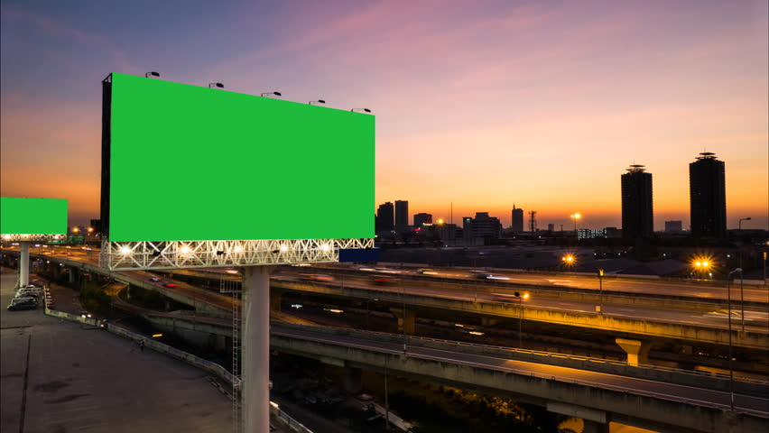 Advertising billboard green screen on sidelines of expressway with traffic at evening, time lapse. | Shutterstock HD Video #13342124