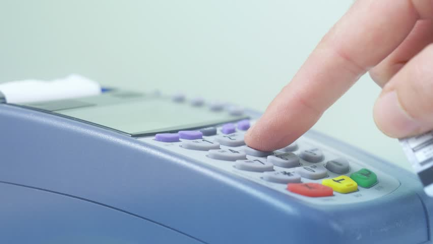 Paying with a credit card on a store terminal and entering the PIN number to complete the transaction. Great to illustrate a shopping experience. | Shutterstock HD Video #13356773