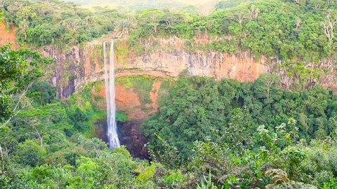 Waterfall in rainforest. Chamarel Falls is a scenic location and nature attraction on Mauritius Island.