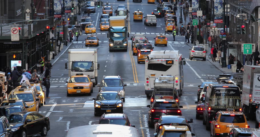NEW YORK - CIRCA DECEMBER 2015: Street traffic and people walking | Shutterstock HD Video #13365083