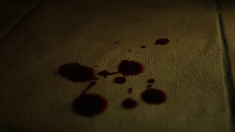 Blood dripping onto tiled floor