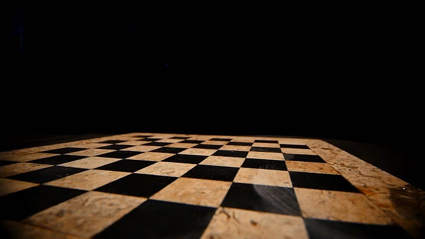 Chess Figures Form On Chess Board And Prepare To Battle On