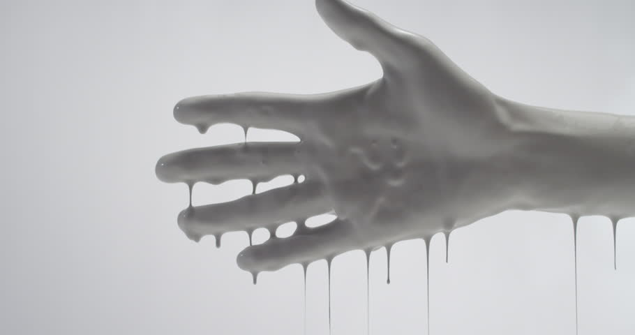 Stock Video Clip of A hand covered in white paint dripping ...