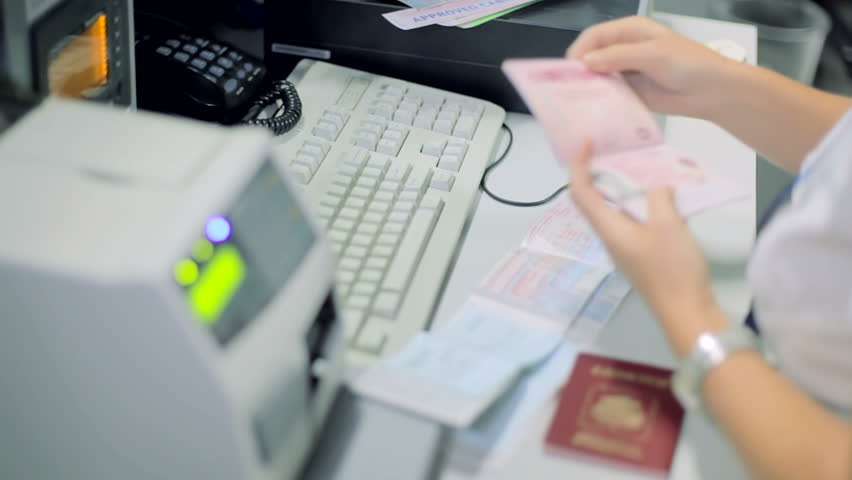 Checking the passports and selling a tickets at the airport counters