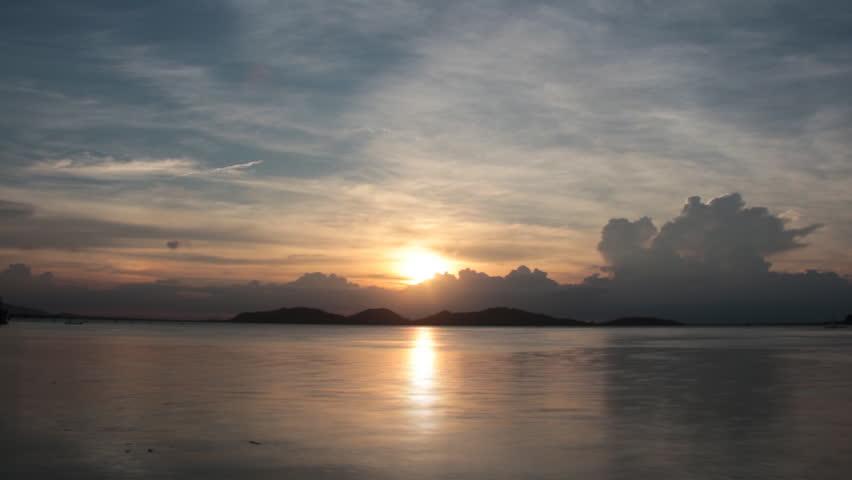 Variable cloud sky sea evening light.