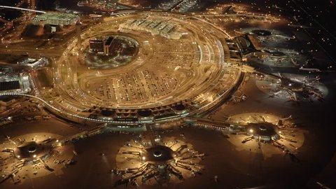 aerial view of illuminated airport at night. International terminal departure and arrival gates. airplane aviation transportation background. shot on red epic