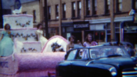 ERIE, PENNSYLVANNIA 1951: Chamber of Commerce parade float women long dresses.