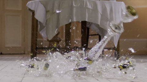 Chandelier falling and breaking on wooden floor . Slow Motion. Shot on RED EPIC Cinema Camera .