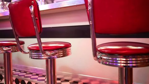 Close up view of seats near bar counter in restaurant