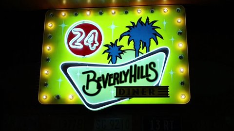 MOSCOW - JAN 18, 2015: Beverly Hills Diner illuminated signboard - network of stylized American restaurants in Moscow