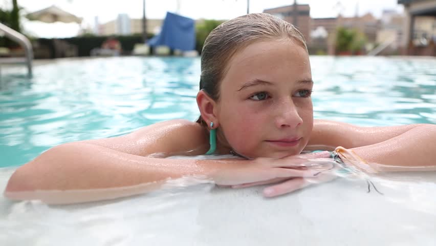 Stock Video Of Pre-Teen Girl Smiling In The Pool -7322