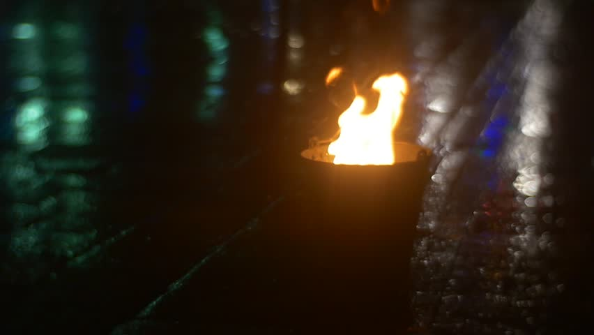 Fire in a Bucket, Torch in a Bucket, Fire Tongues Are Raising Up Dancers are Walking along a Fire, People's Legs, Shadows, Paved Square Lit by Colorful Lights reflection, Dance Troupe after | Shutterstock HD Video #13585133