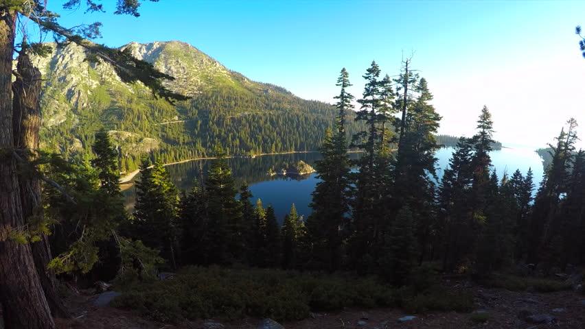 LAKE TAHOE, NEVADA - CIRCA 2015 - A beautiful aerial shot at dawn over Emerald Bay Lake Tahoe. | Shutterstock HD Video #13596356