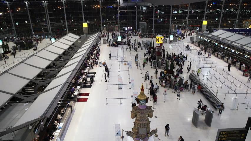 Crowd of tourist entering-leaving the Suvarnabhumi International Airport at night.   Shutterstock HD Video #13601513