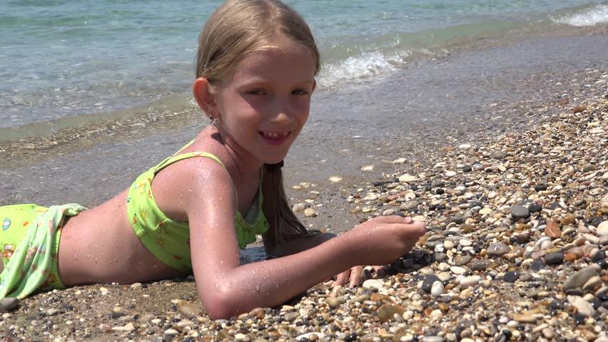 K Happy Little Girl Playing Pebbles On Beach Child At Seashore Seaside Summer Stock Footage Video  Shutterstock