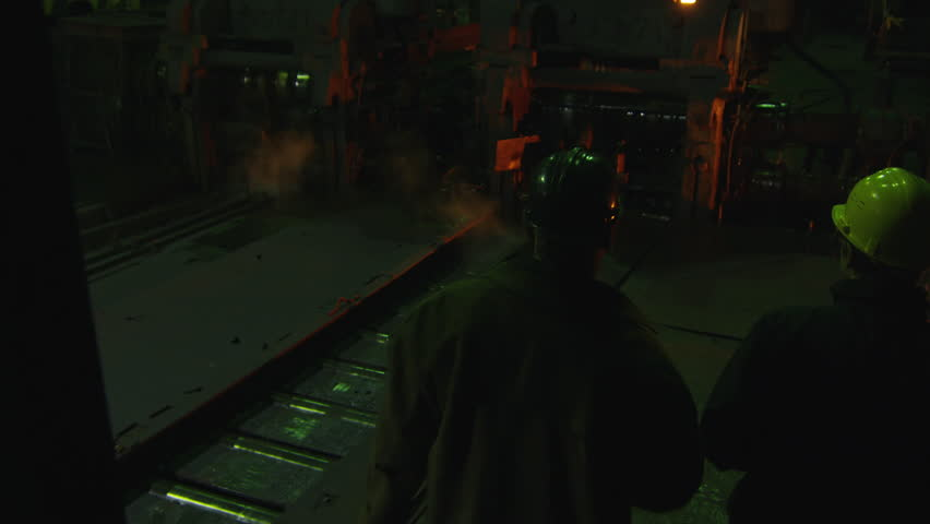 engineer and worker walking and have conversation in foundry industrial environment shot on - Glow Stick Halloween Decorations